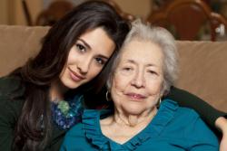 caregiver hugging old patient